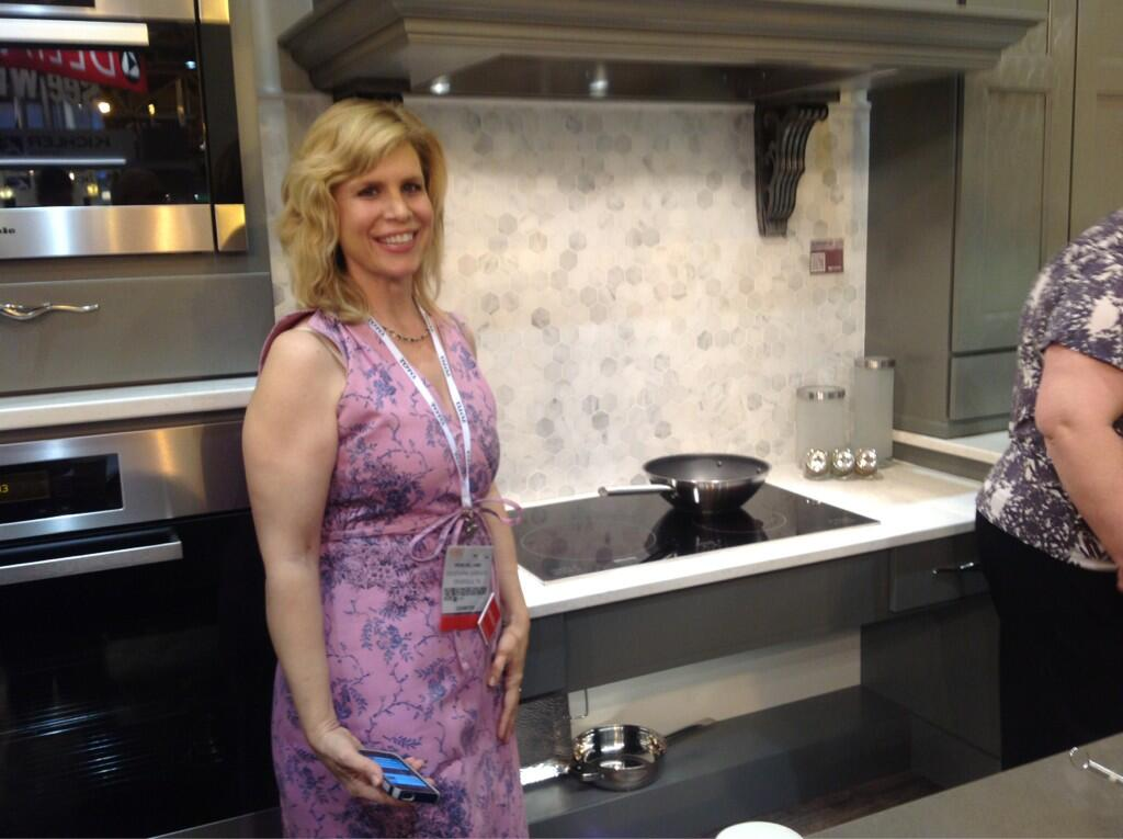 @Crossville Tile was a partner in the Wellborn Cabinet booth! Here Irene Williams stands by their tile backsplash during a tour of the booth given by Wellborn designer Karen Stanley.