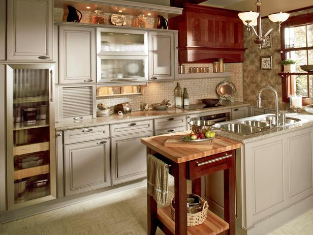 Monterey kitchen cabinets in Pebble Java a taupe painted finish with a light gray Pewter glaze