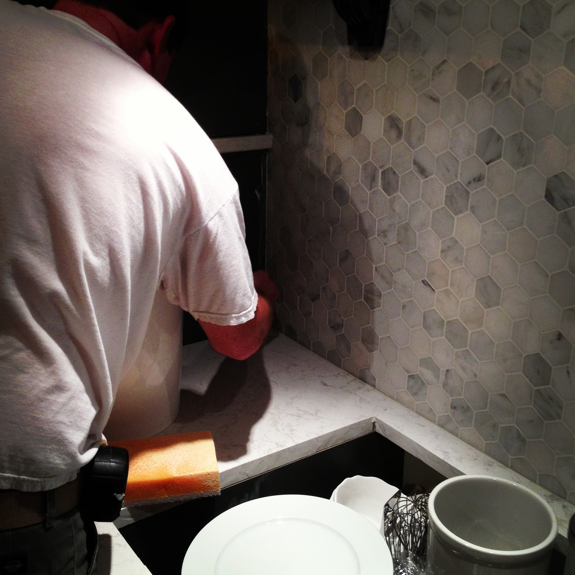 Tim hard at work grouting after the displays arrive at the show