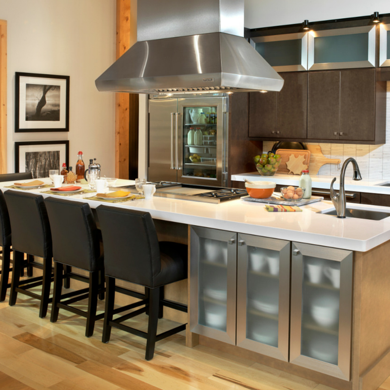 Kitchen Island With Cooktop islands- the heart of the kitchen | wellborn cabinet blog
