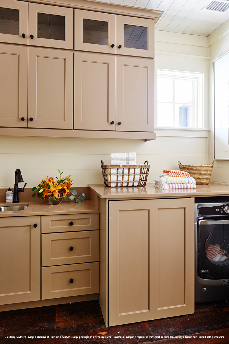 2017 Southern Living Idea House Upstairs Laundry Room - featuring Wellborn Cabinet, Inc, - Bishop MDF with a Classic Drawer Front, in a ColorInspire, Dormer Brown Painted finish, SW 7521