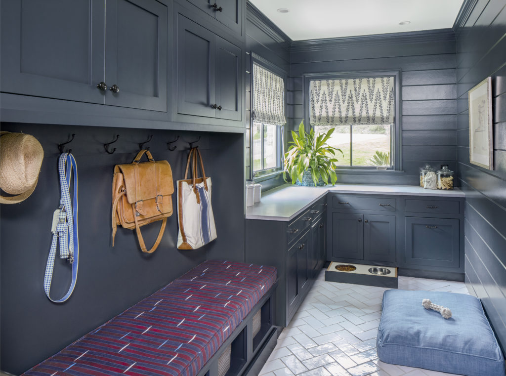 navy shaker laundry room cabinets with pet accessories