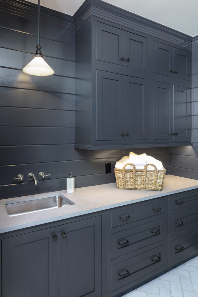 navy shaker laundry room cabinets and shiplap walls