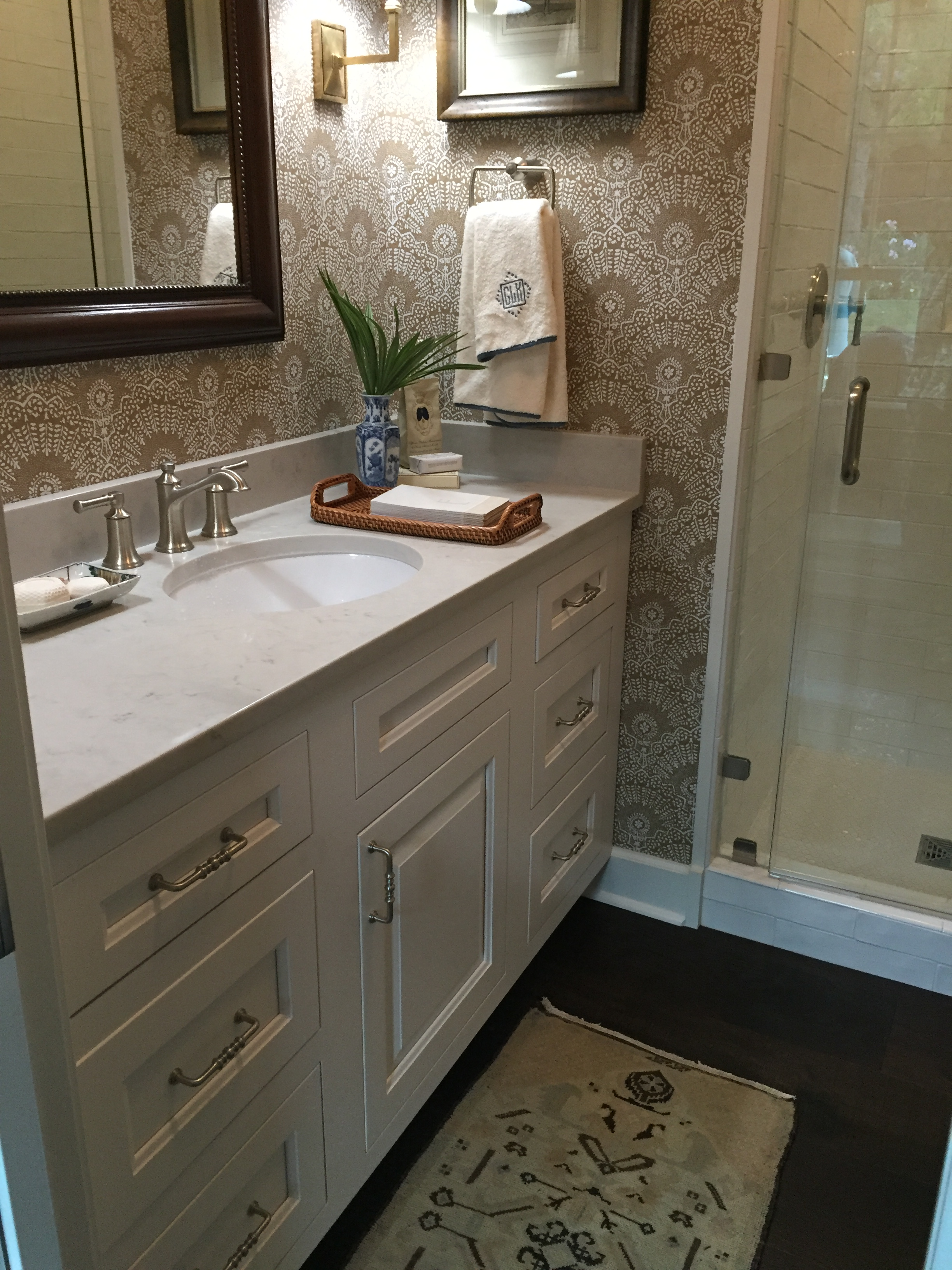 the bathroom is finished with wellborns premier cabinetry line non beaded inset davenport square