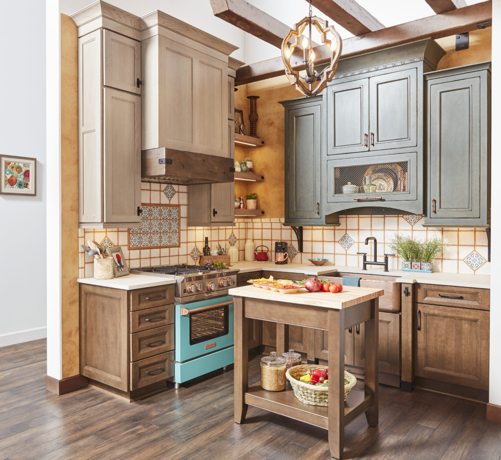 warm stain kitchen cabinets, colorful decorative tile, exposed wood beams, wrought iron