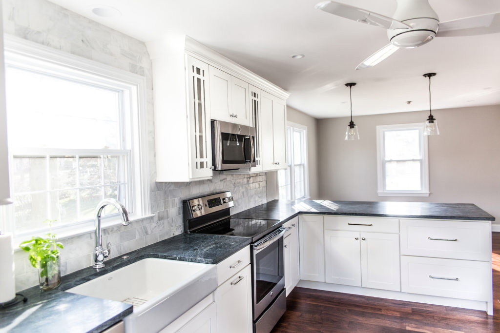white shaker style cabinetry in kitchen small kitchen