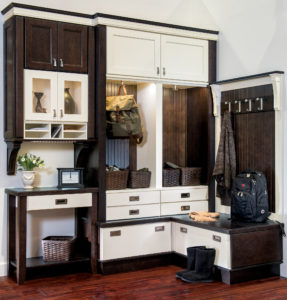 traditional white and dark brown mudroom cabinets