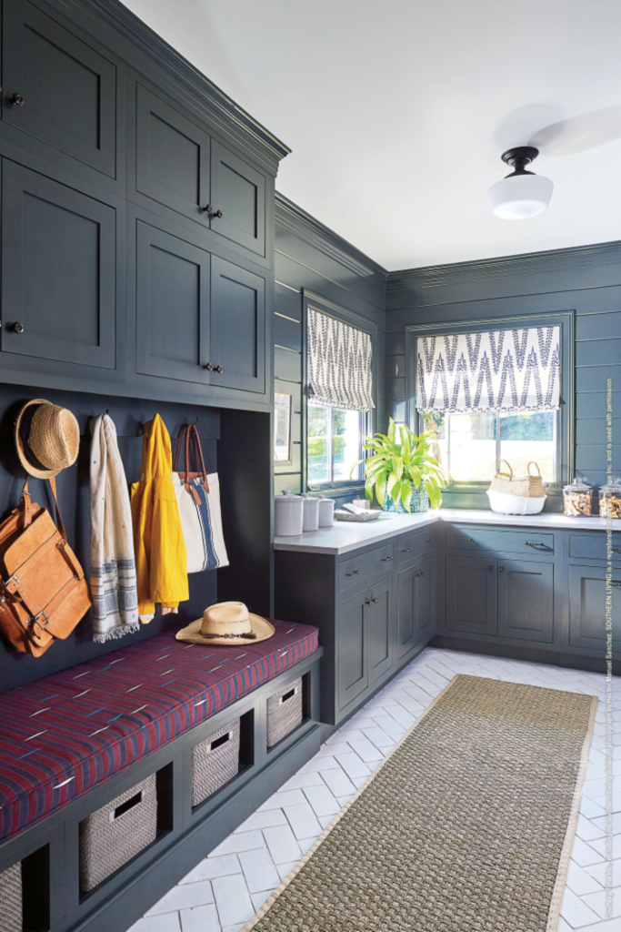 navy shaker mudroom with storage solutions