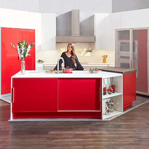 Contemporary high gloss red and white Midtown Designer Laminate kitchen cabinets featuring a Fresno Metal Door with Low-Iron Satin Glass