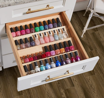 nail polish displayed in wellborn cabinet's spice rack insert for bathroom organization