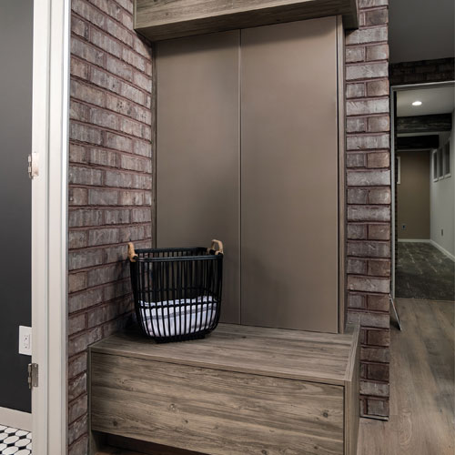 Country, contemporary frameless mudroom cabinets in Bel-Air Bark Maple texture laminate with Vista metal Mocha Matte back-painted glass doors