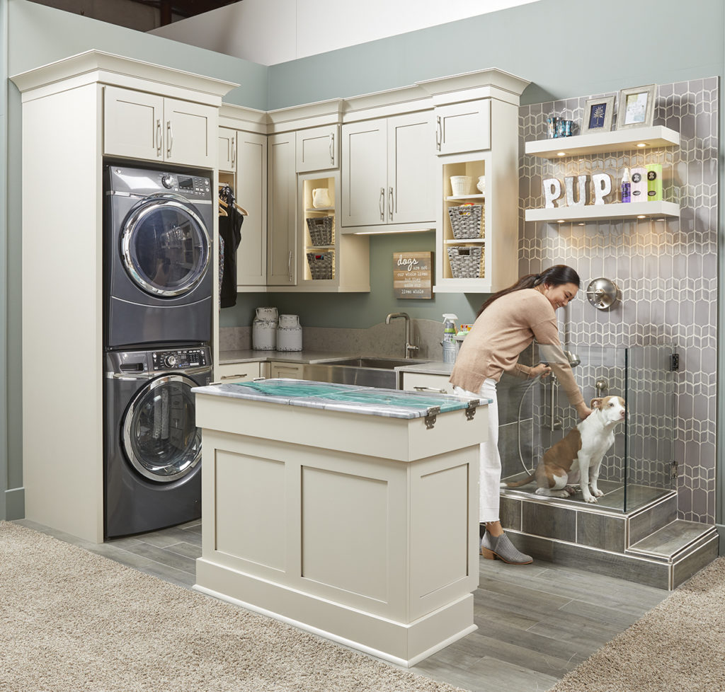 warm beige gray laundry room cabinets
