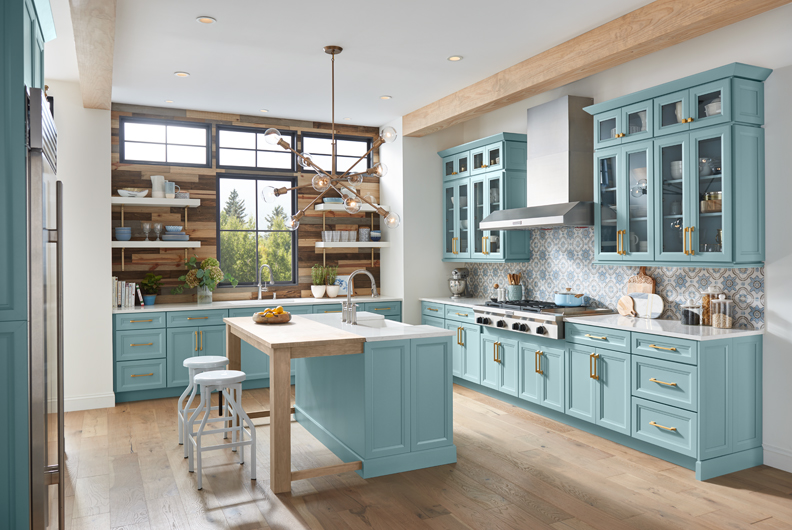 Light blue kitchen cabinets and island